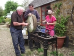 Putting together an ancient grinding stone